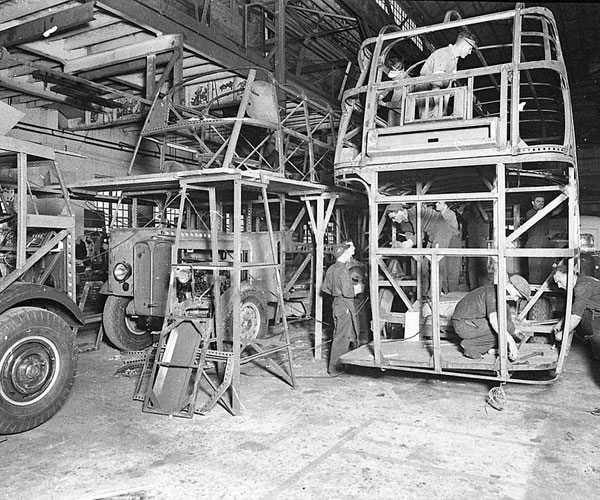 men working on bus frame